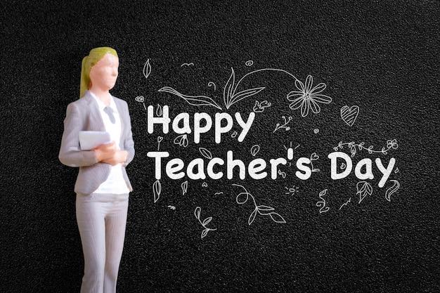 Miniature people teacher in front of blackboard ,world teacher day concept