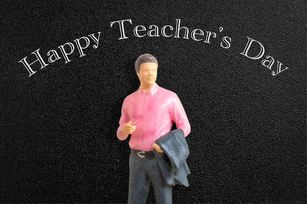 Miniature people teacher in front of blackboard world teacher day concept