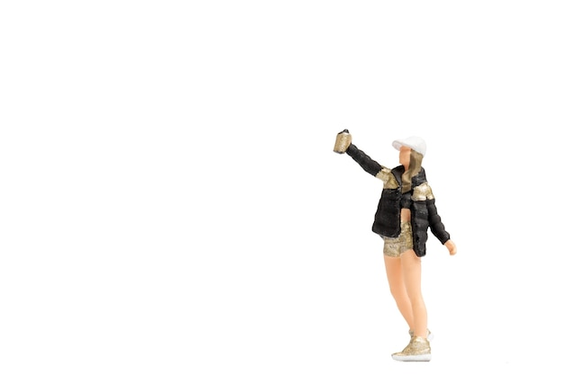Miniature people teenager spraying paint from can on white background and space for text