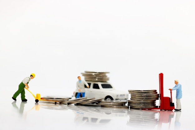 Miniature people transporting coins