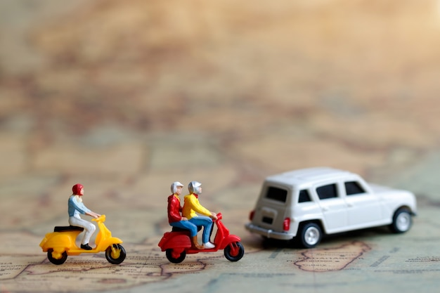 Miniature people traveling