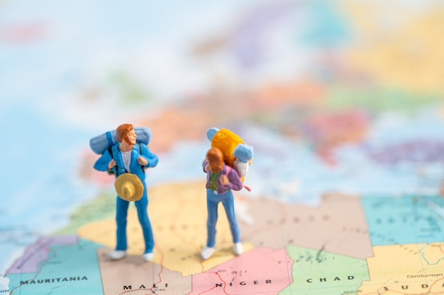 Miniature people two backpacker enjoy to discovery journey travel