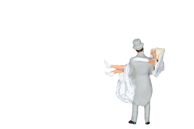 Miniature people : wedding bride and groom isolated on white
