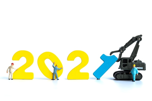 Miniature people : worker team build wooden number 2021 , happy new year concept