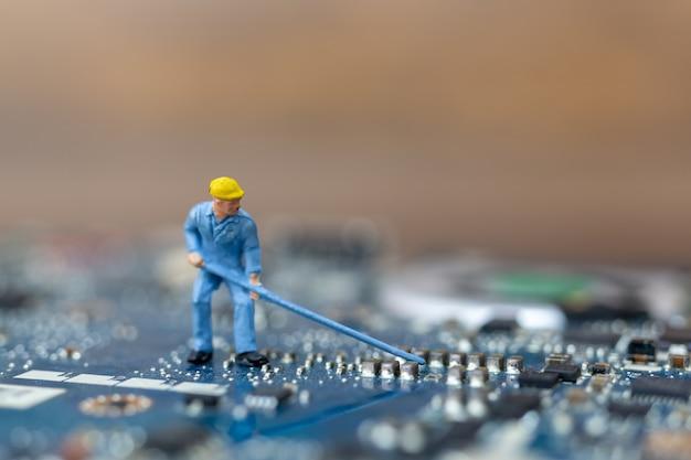 Miniature people working on cpu board