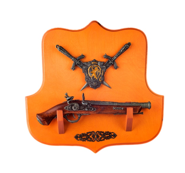 Miniature pistol, daggers and coat of arms isolated