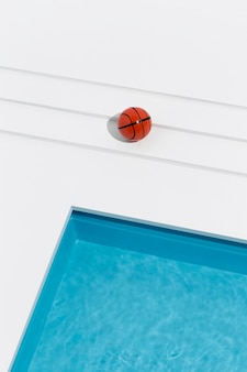 Miniature pool still life assortment with basketball