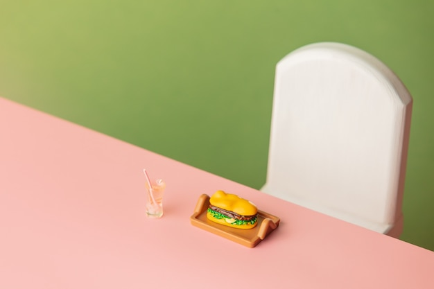 Miniature sandwich on pink table