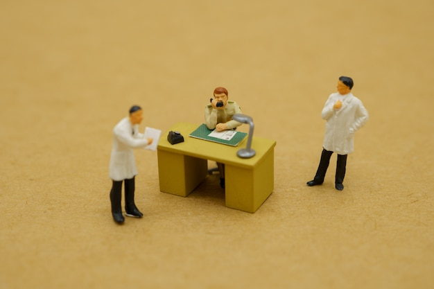 Miniature toy of doctors and government officials