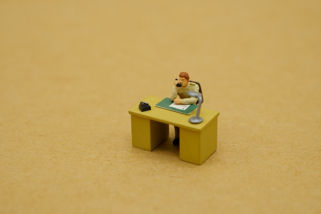 Miniature toy of government officials talking by phone