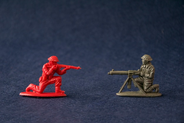 Miniature toy soldiers fighting.