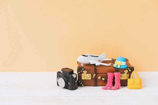 Miniature travel accessories and items with copy space