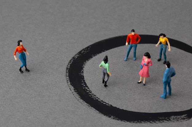 Miniature woman outside and people in circles