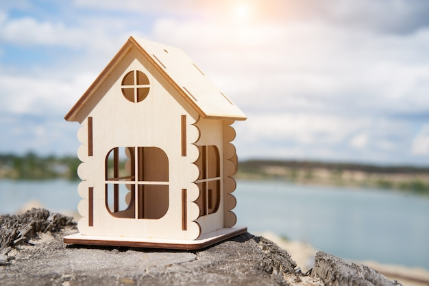 Miniature wooden house outdoor nature. real estate concept. modern housing. eco-friendly energy efficient house. buying home outside the city fresh air.