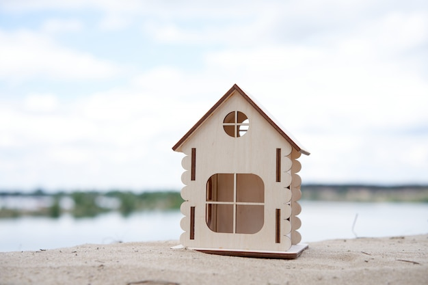 Miniature wooden house outdoor nature. real estate concept