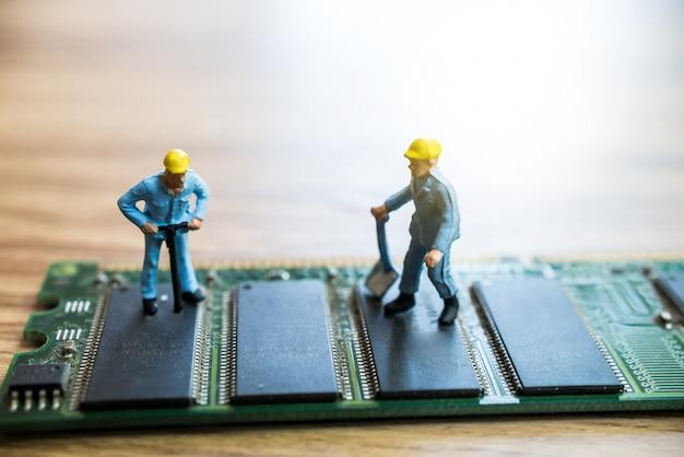 Miniature worker repairing circuit motherboard