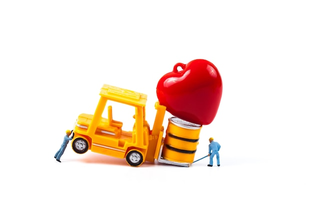 Miniature worker and small forklift with love heart sign