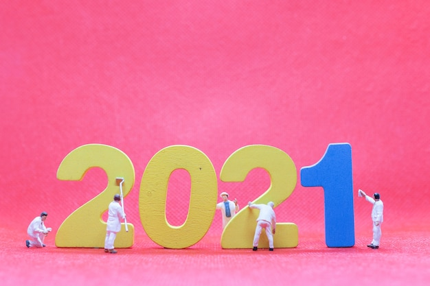 Miniature worker team painting number 2021  , happy new year concept