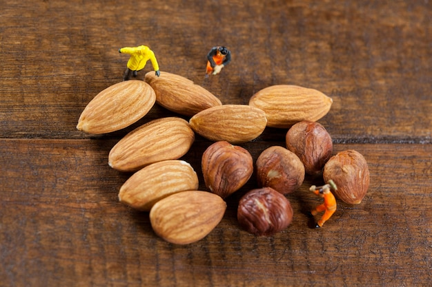 Miniature workers working with almonds and nuts