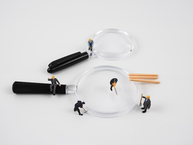 The miniature works on a magnifying glass and the background is white