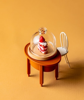 Miniature xake under glass on a table on yellow background
