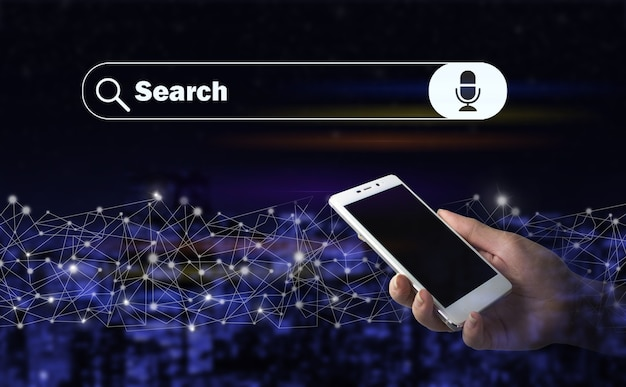 Minimal blank search bar with voice command. hand hold white smartphone with digital hologram search data sign on city dark blurred background. searching internet data. web browsing concept.