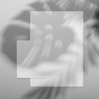 Minimal brochure overlay with vegetation shadow