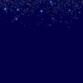 最小限のクリスマスの夜の青い輝きの背景テキスト用のスペース