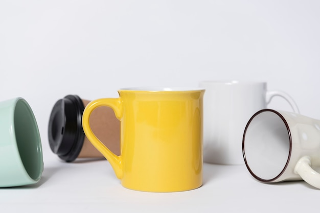 Minimal coffee cup on table. mock up for creative design branding object.