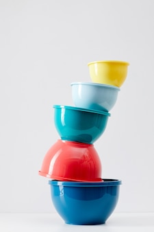 Minimal composition of colorful food containers stacked, plastic storage and recycling concept