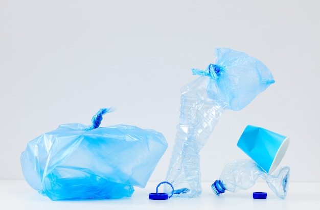 Minimal composition of discarded blue plastic items, waste sorting and recycling concept