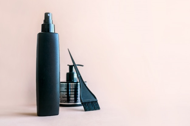 Minimal composition with black hair salon tools