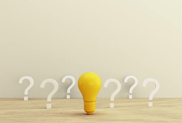 Minimal concept creative idea and innovation. yellow light bulb revealing an idea with question mark on a wood background.