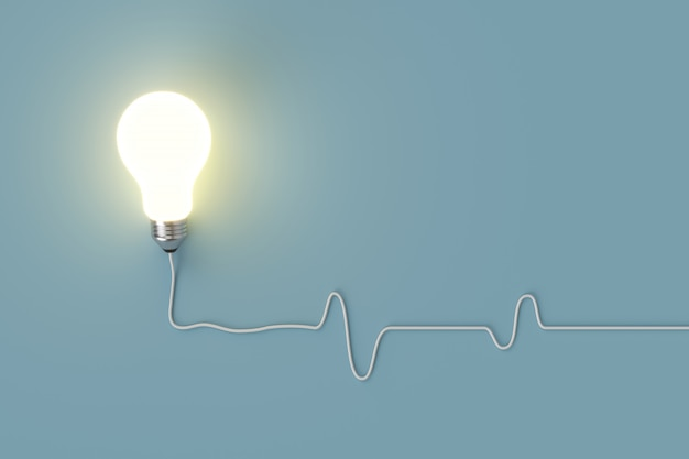 Minimal concept. outstanding glowing light bulb with cable on blue background for copy space.