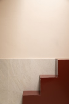 Minimal empty space scene with red stair and pink wall in shade for photoshoot / studio concept / outdoor studio / modern minimal style
