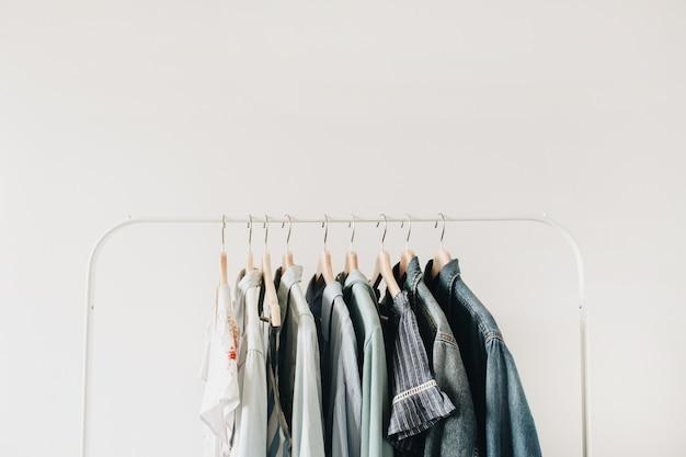 Minimal fashion concept. female clothes on hanger on white