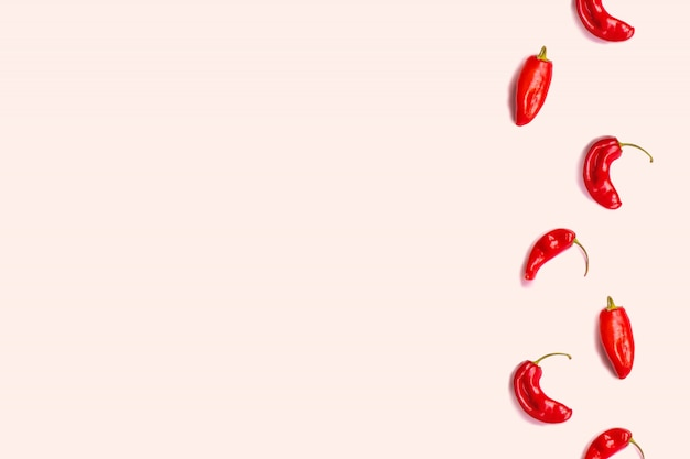 Minimal food concept. creative layout of chili pepper on pink background.