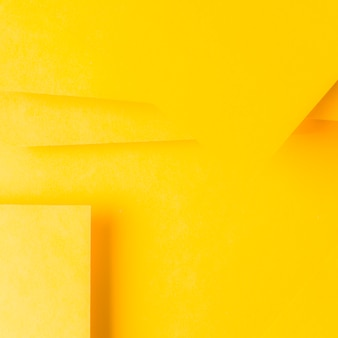 Minimal geometric shapes and lines on yellow paper