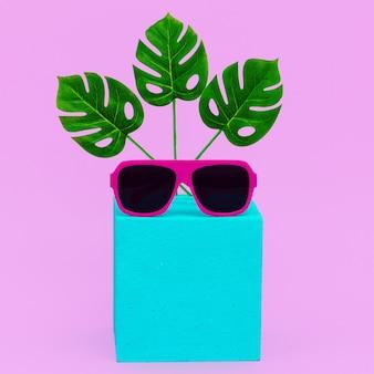 Minimal geometry composition fashion accessories sunglasses. beach tropical creative concept