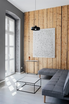 Minimal home decor with an artwork on a wooden wall
