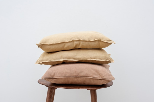 Minimal linen cushion covers on a chair