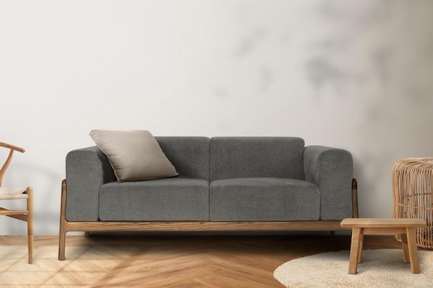 Interior design minimale del soggiorno con ombra di foglie su un muro