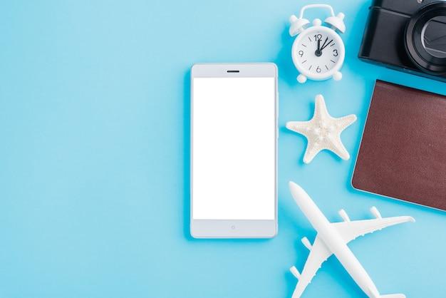 Minimal model plane airplane starfish alarm clock compass and smartphone blank screen