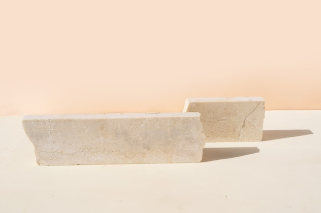 Minimal modern product display on textured beige background