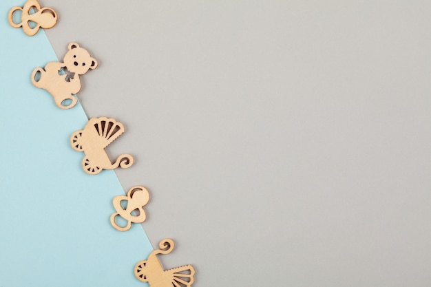 Minimal pastel decorative background with small wooden figures for newborn birthday