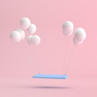 白い風船と浮かぶ青いスイングチェアの最小限のシーン。