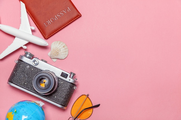 Minimal simple flat lay travel adventure trip concept on pink pastel trendy modern background