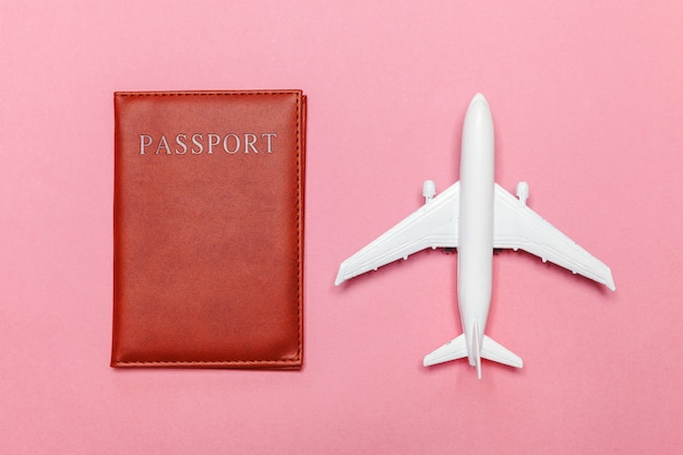 Minimal simple flat lay travel adventure trip concept with plane and passport