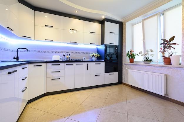 Minimal simple white large modern kitchen interior, closeup