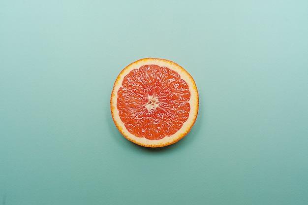 Minimal style, creative layout orange and grapefruit  on turquoise background